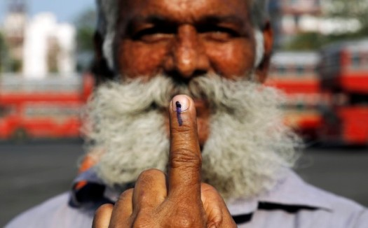 An Indian man displays the indelible ink mark on his finger after casting his vote in Mumbai India - source www.dailymail.co.uk