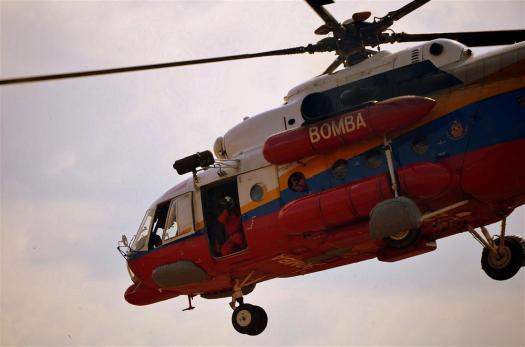 The FRSD's Mi-171 takes off carrying three critically-injured survivors during SAREX LIMA 15