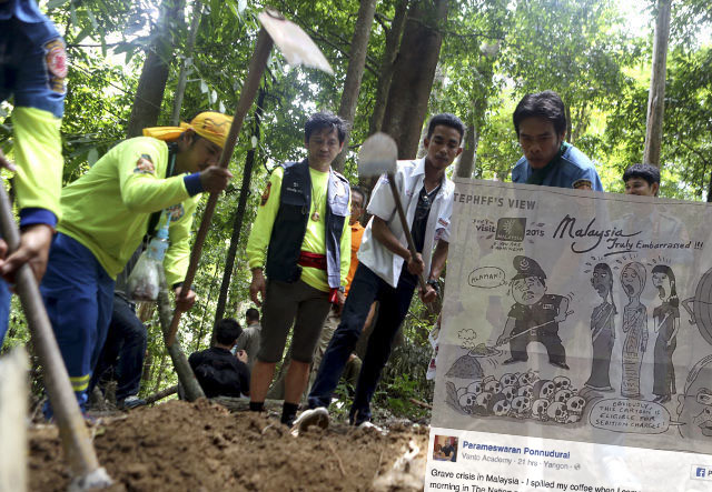 Malaysian authorities dig up mass graves along the Malaysian-Thai border, and the cartoon published by Nation News of Thailand (pic by Siakapkeli.my)