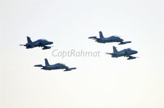 RMAF BAe Hawks and Aermacchi MB-339CM light fighter/lead trainers flying past during the Air Force Day parade