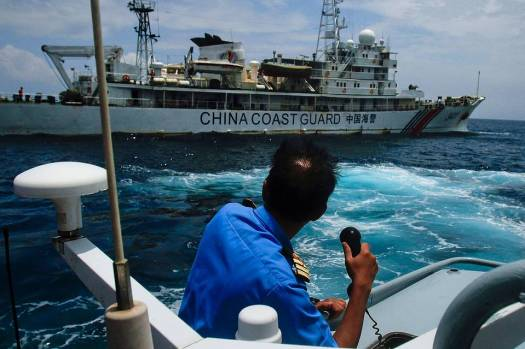 A Malaysian vessel intercepts a Chinese Coast Guard cutter at the Luconia Shoals off Sarawak, Malaysia - picture courtesy of WSJ