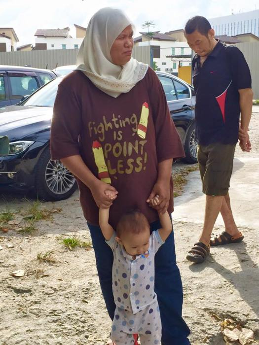 T-shirt worn by the wife of a Queensbay fisherman expresses the helplessness they feel