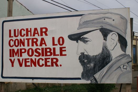 "A Wikipedia image of a Cuban propaganda poster proclaiming a quote from Castro: ""Luchar contra lo imposible y vencer"" (""To fight against the impossible and win"")"