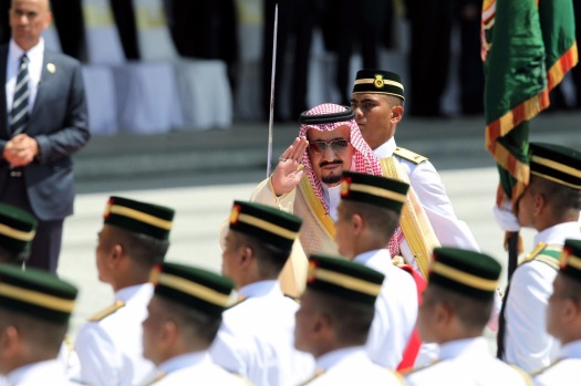 King Salman Abdulaziz Al-Saud salutes the colours